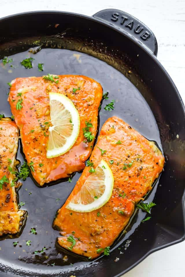 Flipping the salmon over to sear the skin side