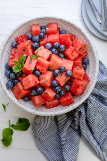 Watermelon Blueberry Salad in a large bowl with mint, honey and lemon juice