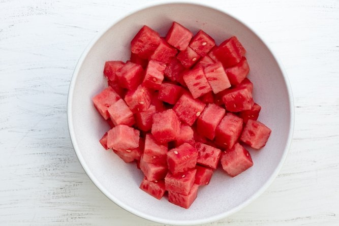 Large white bowl of cubed watermelon pieces
