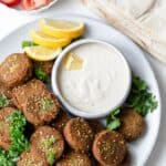 Falafel patties with falafel sauce, pita and tomatoes
