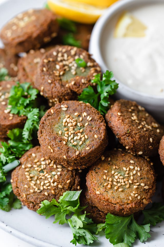 Close up shot of falafel patties with sesame seeds sprinkled on top