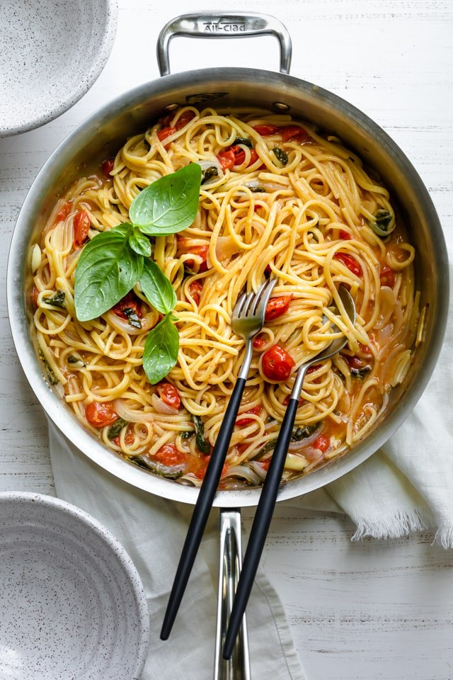 One pan pasta recipe made with spaghetti, tomatoes, spinach, basil, onions and garlic