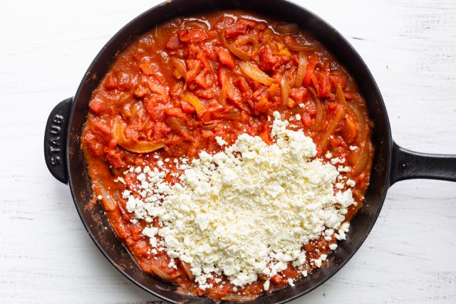Added feta cheese to the skillet with the spiced tomato sauce