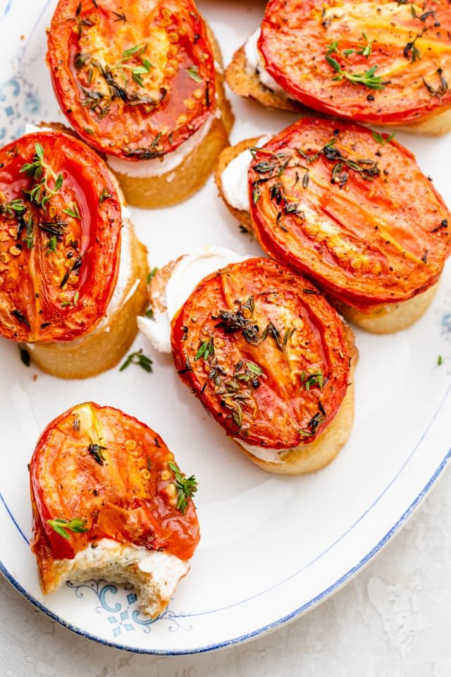 overhead shot of roasted tomatoes on crostinis