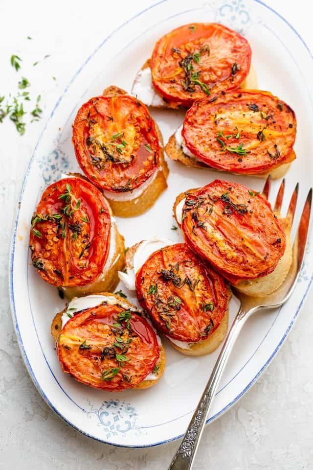 Final crostini with roasted tomatoes appetizer dish