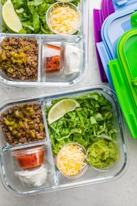 Taco salads prepped in glass meal prep containers