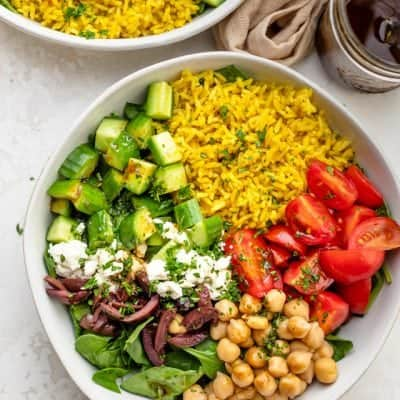 Turmeric rice salad with dressing on top