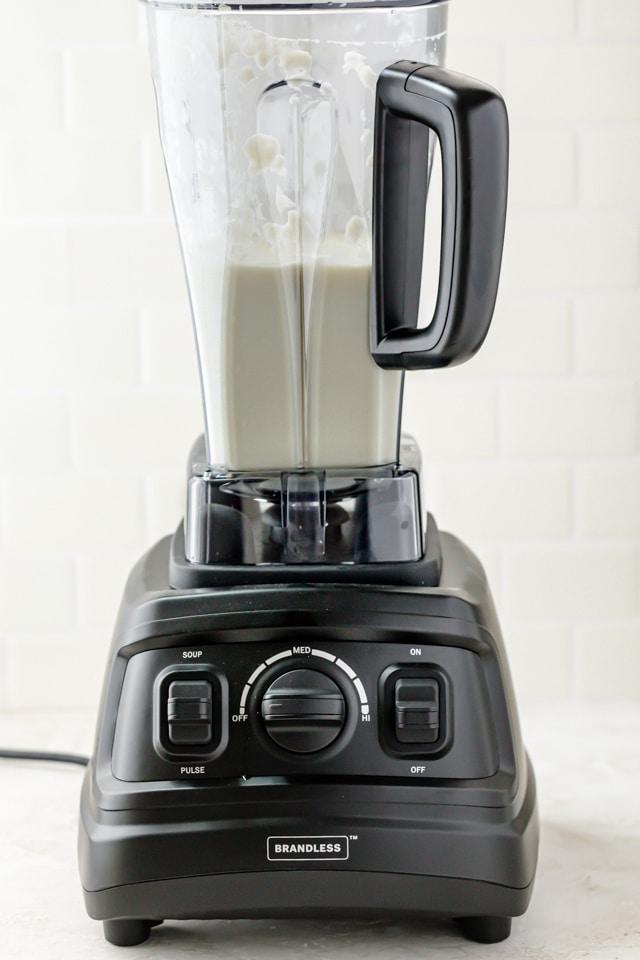 Brandless Blender blending vegan alfredo sauce