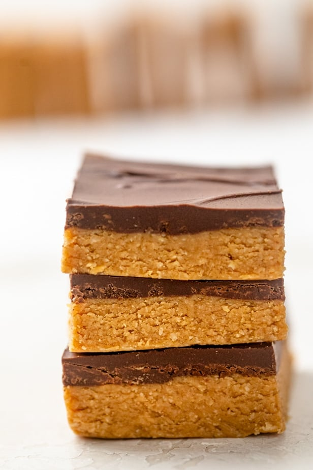 Vertical stack of 3 chocolate peanut butter bars