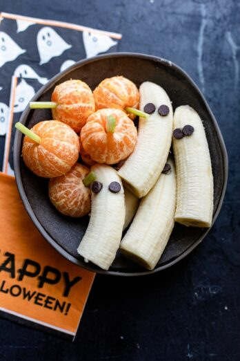 Halloween Themed Food - Final plated ghost bananas and tangerine pumpkins