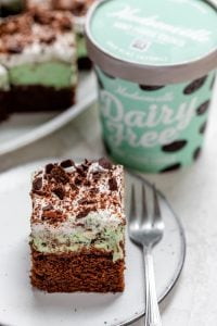 Slice of mint chocolate brownies with the dairy free mint chip ice cream in the background
