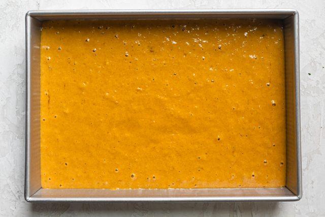 Prepared batter in large baking pan before baking