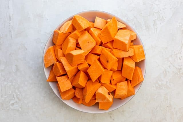 Peeled and chopped sweet potatoes in a large bowl
