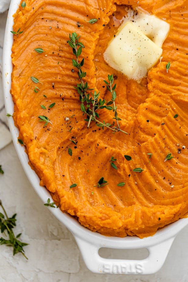 Close up of the mashed sweet potatoes topped with butter