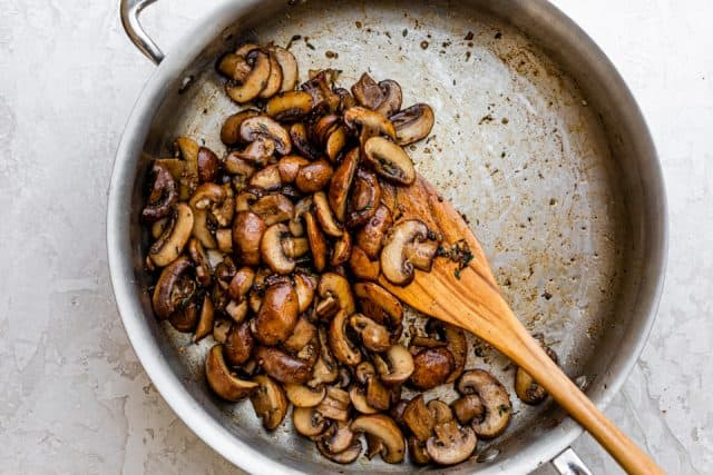 Showing how to caramelized mushrooms in a pan