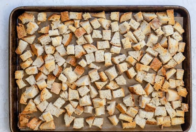 Toasted bread cubes on a baking sheet