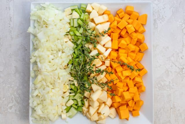 The vegetables that are in the stuffing recipe on a white plate