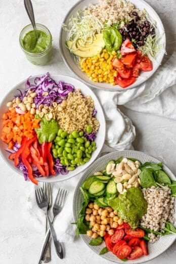 Three grain bowls with toppings