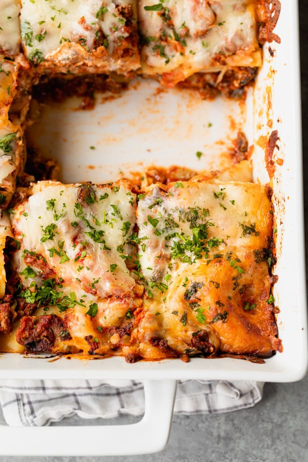 Baking pan with lasagna slices cut out