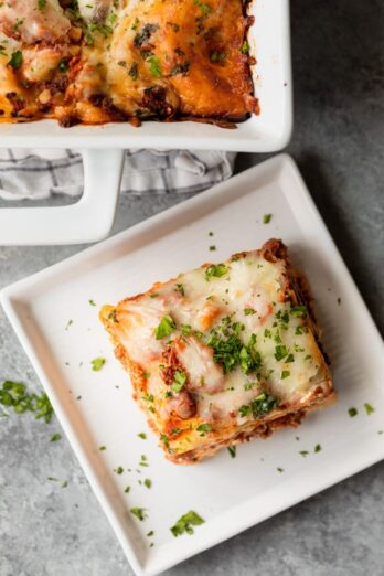 Homemade lasagna recipe, slice cut out of baking dish