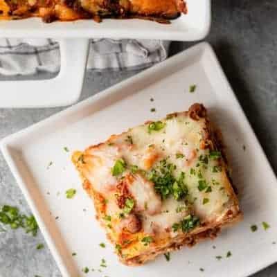 Homemade lasagna recipe, slice cut out of baking dish
