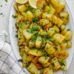 Lebanese Spicy Potatoes, also know as Batata Harra served with fresh cilantro and lemon wedges