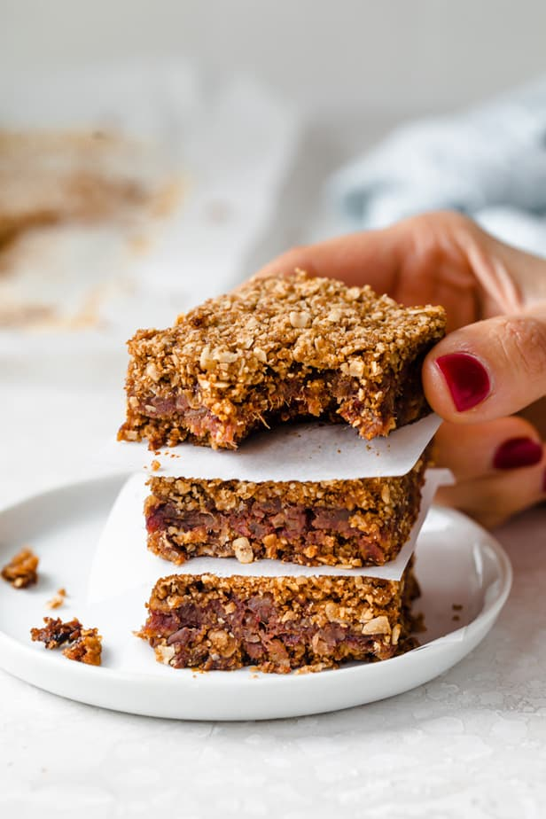A pecan date bar with a bite taken out of it