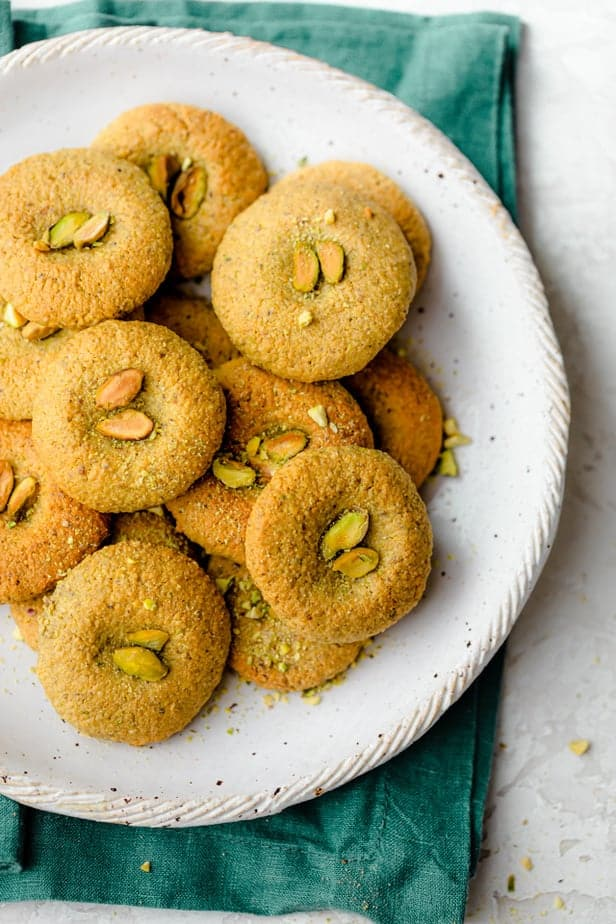 Plate of holiday pistachio cookies topped with pistachio pieces
