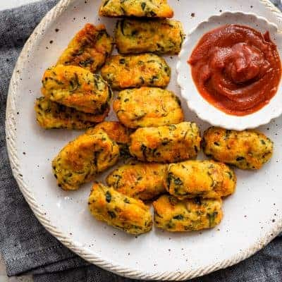 Plate of zucchini tots served with ketchup