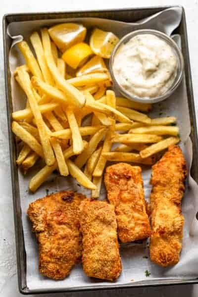 Air fried fish and chips served with tartar saucse and lemon wedge