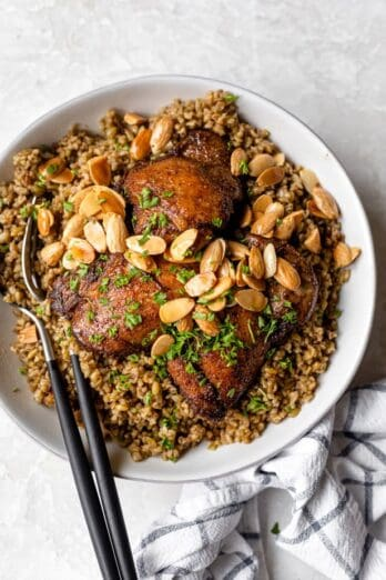 Freekeh with chicken served with toasted nuts and herbs