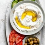 Labneh spread in a bowl with olive oil and zaatar