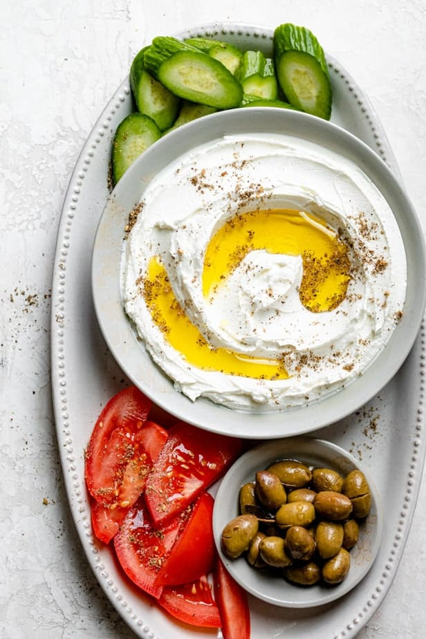 Slices of fresh vegetables and dip with olive oil