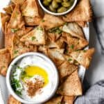 Platter of pita chips with labneh