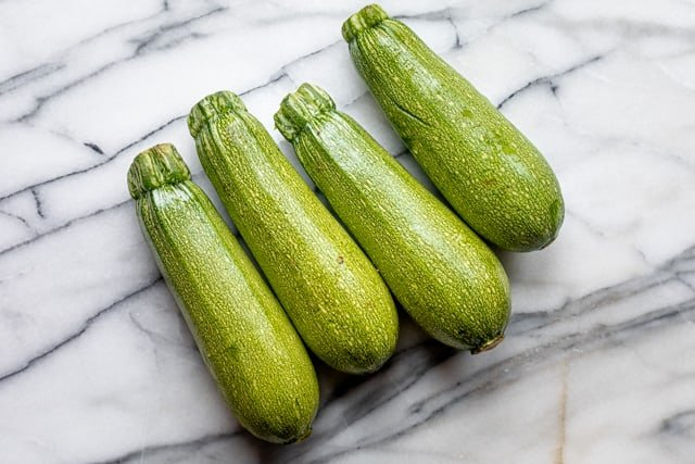 four squash on a counter