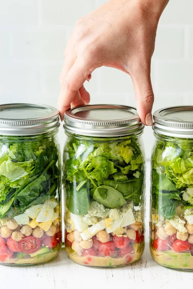 Closing the vegetarian cobb salad jars