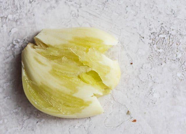 close up of garlic clove crushed