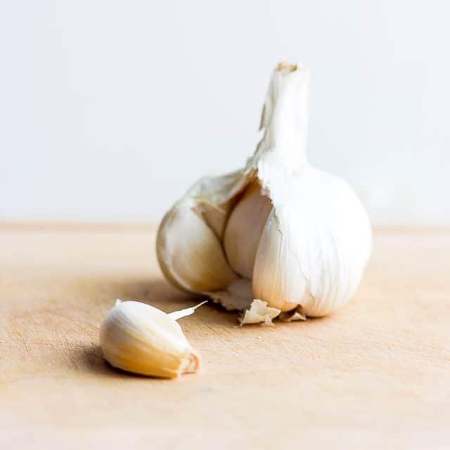 Garlic bulb with one garlic clove removed