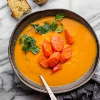 Carrot ginger soup served with crusty bread