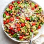Large bowl of chickpea salad topped with feta cheese