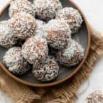 Coconut date balls in a shallow bowl