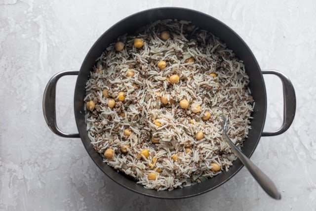 Ground beef and rice in a large pot ready to serve