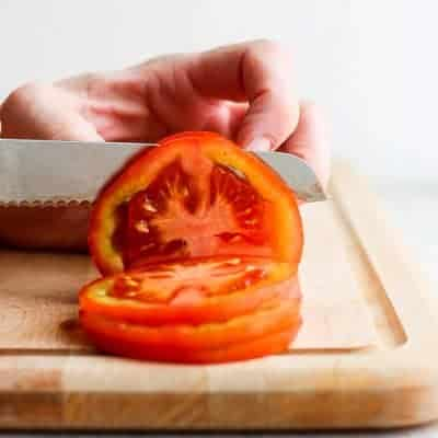 Cutting tomato into slices