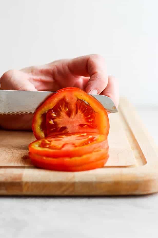 knife cutting through a tomato
