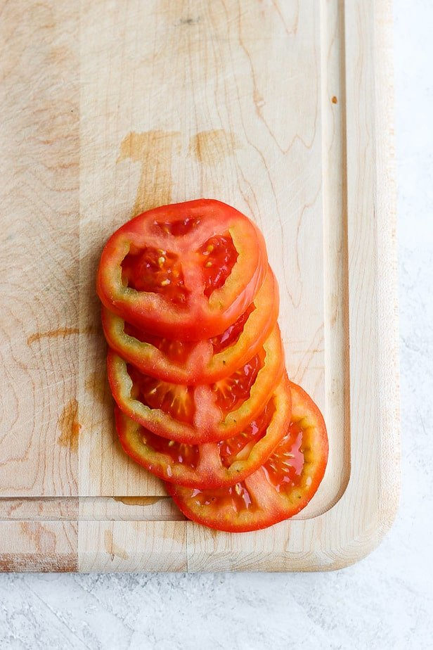 Pretty sliced tomatoes on a cutting board