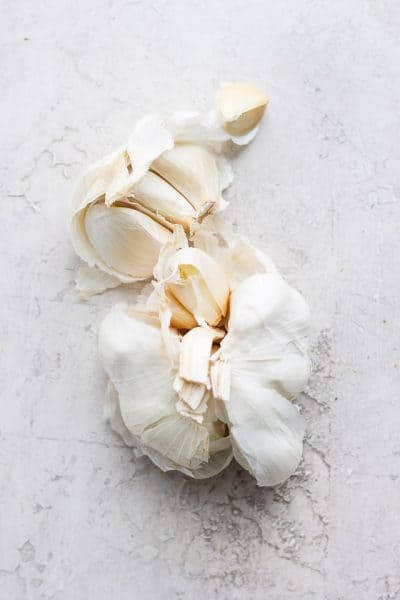 Garlic bulb with cloves peeled away