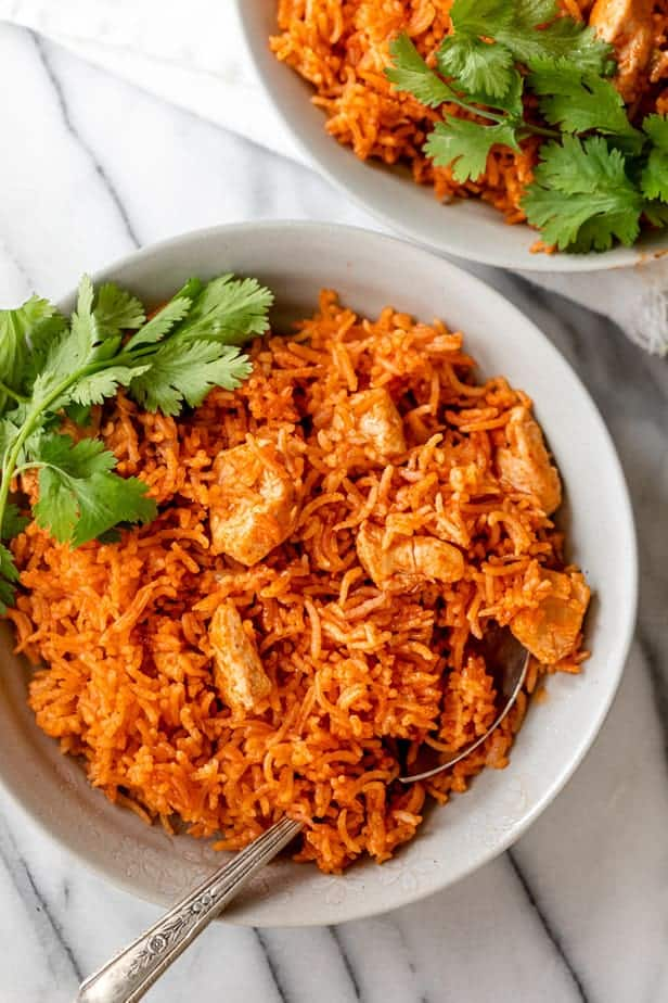 Bowl of Mexican chicken and rice served with cilantro