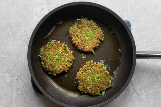 Fritters on a pan getting fried