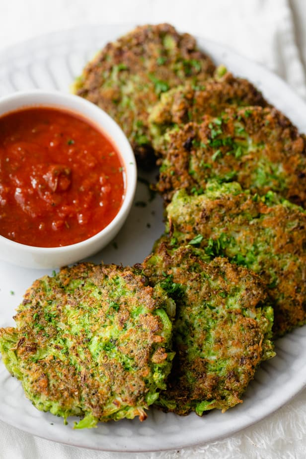 Close up shot of the broccoli fritters served with marinara sauce