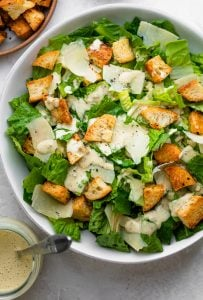 Caesar salad topped with the homemade dressing